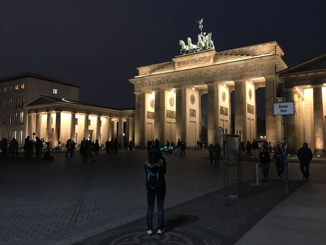 Architecture Built Structure Large Group Of People Building Exterior City Gate Travel Destinations Real People City Tourist Tourism Travel Illuminated Architectural Column History Sky Women Night Outdoors Statue Sculpture Brandenburg Gate