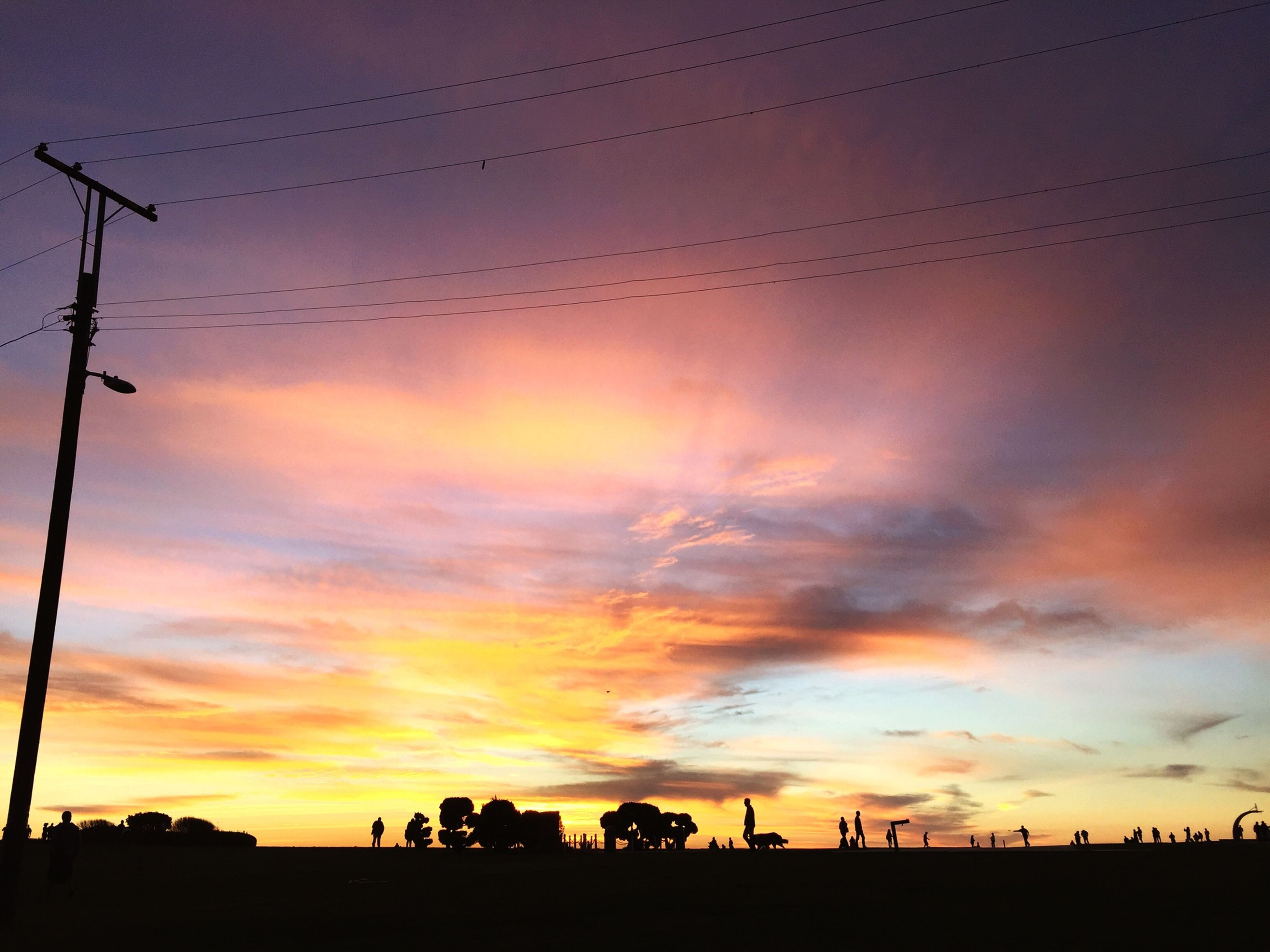 sunset, silhouette, sky, orange color, beauty in nature, scenics, cloud - sky, low angle view, tranquility, nature, tranquil scene, power line, electricity pylon, dramatic sky, idyllic, cloud, street light, dusk, outline, outdoors