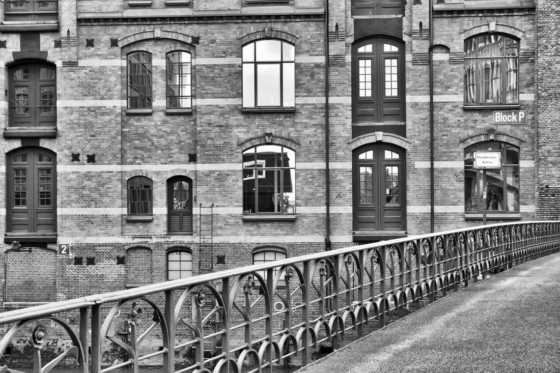 Speicherstadt Architecture Black & White Black And White Blackandwhite Brick Wall Bridge Building Built Structure Bw Bw_collection City Exterior Façade Footpath Germany Hafencity Hamburg Handrail  Harbour Mirror Window No People Outdoors Reflection Speicherstadt Windows