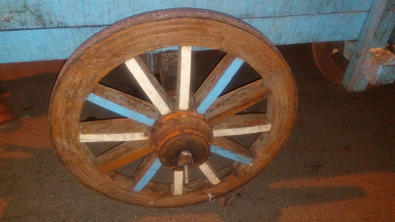 wagon wheel, wheel, wood - material, old-fashioned, circle, history, no people, day, indoors, helm, close-up
