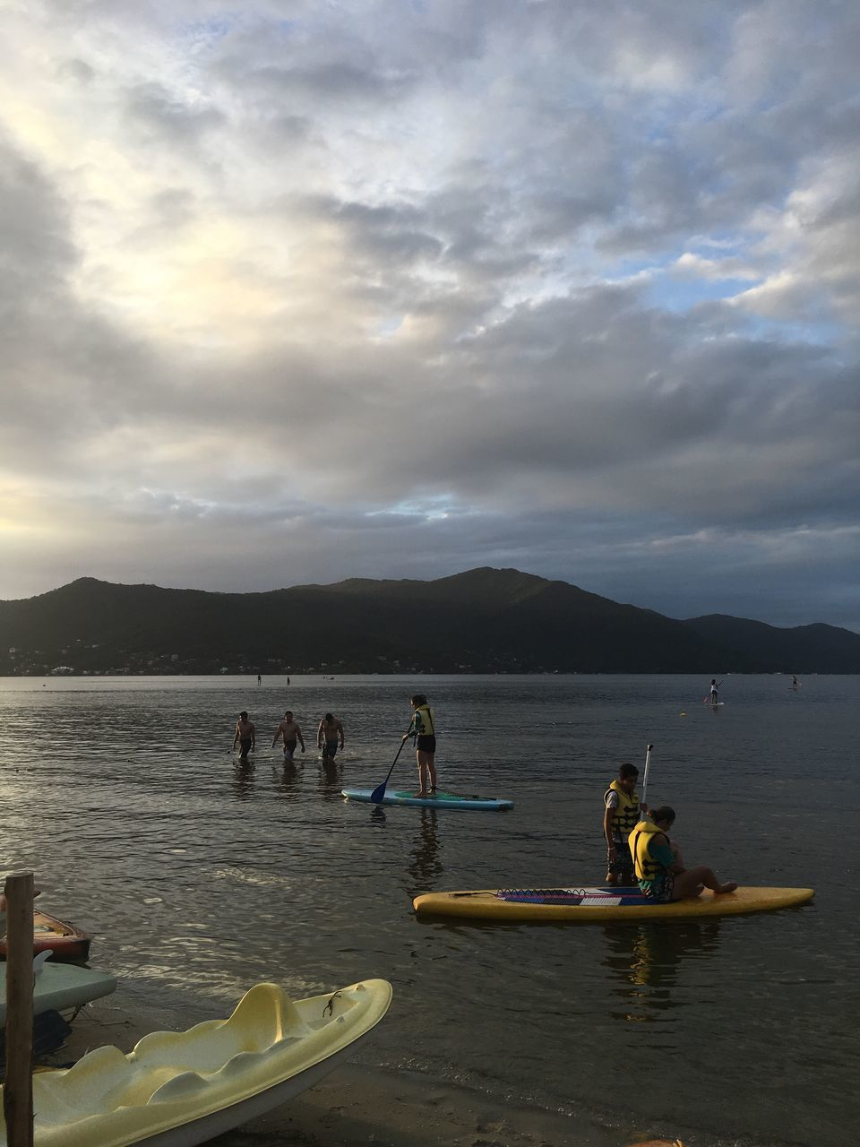 sky, cloud - sky, real people, water, nature, nautical vessel, outdoors, oar, mountain, leisure activity, teamwork, sport, togetherness, transportation, day, men, scenics, lifestyles, beauty in nature, people, adult