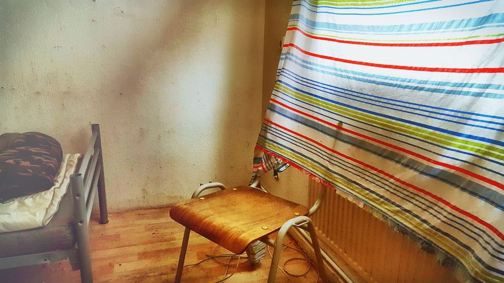 Bad Bad Condition Bed Chair Curtain Day Dirty Dirty Wall Home Interior Homeless Indifference Indifferent Indoors  Interior No People Old Buildings Old House Residence Still Life Striped Stripes Pattern Wall Window Wooden Wooden Chair