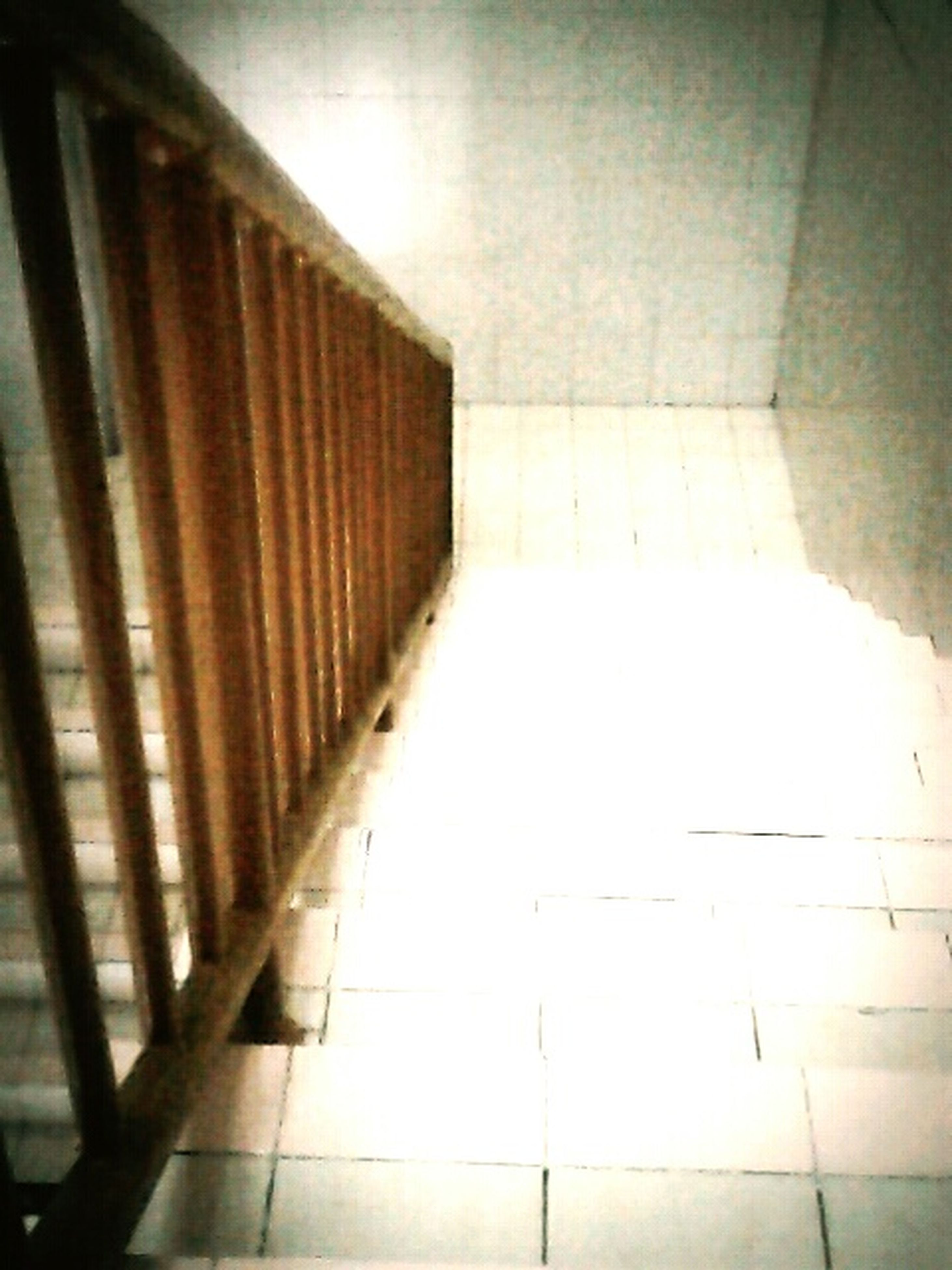 indoors, architecture, tiled floor, built structure, corridor, flooring, empty, wall - building feature, tile, ceiling, absence, the way forward, building, modern, shadow, sunlight, wall, no people, home interior, illuminated