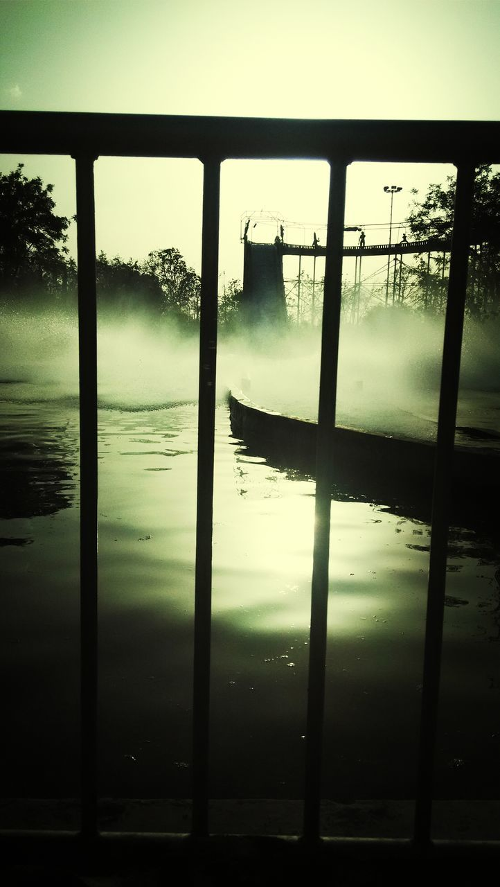 water, reflection, silhouette, sky, window, lake, nature, day, no people, outdoors, tree, beauty in nature