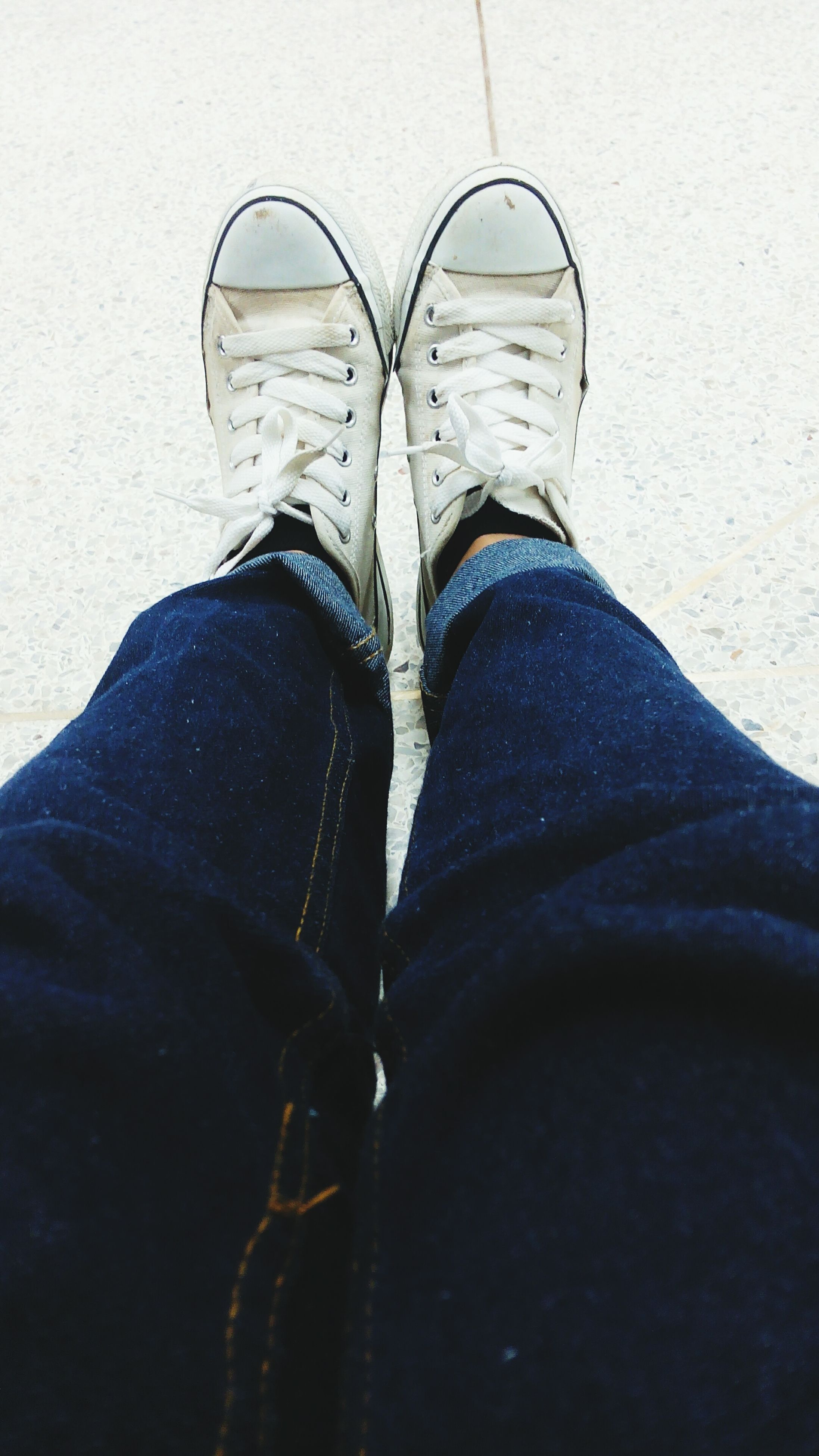 low section, shoe, person, jeans, footwear, standing, lifestyles, personal perspective, indoors, fashion, human foot, casual clothing, canvas shoe, high angle view, denim, leisure activity, men