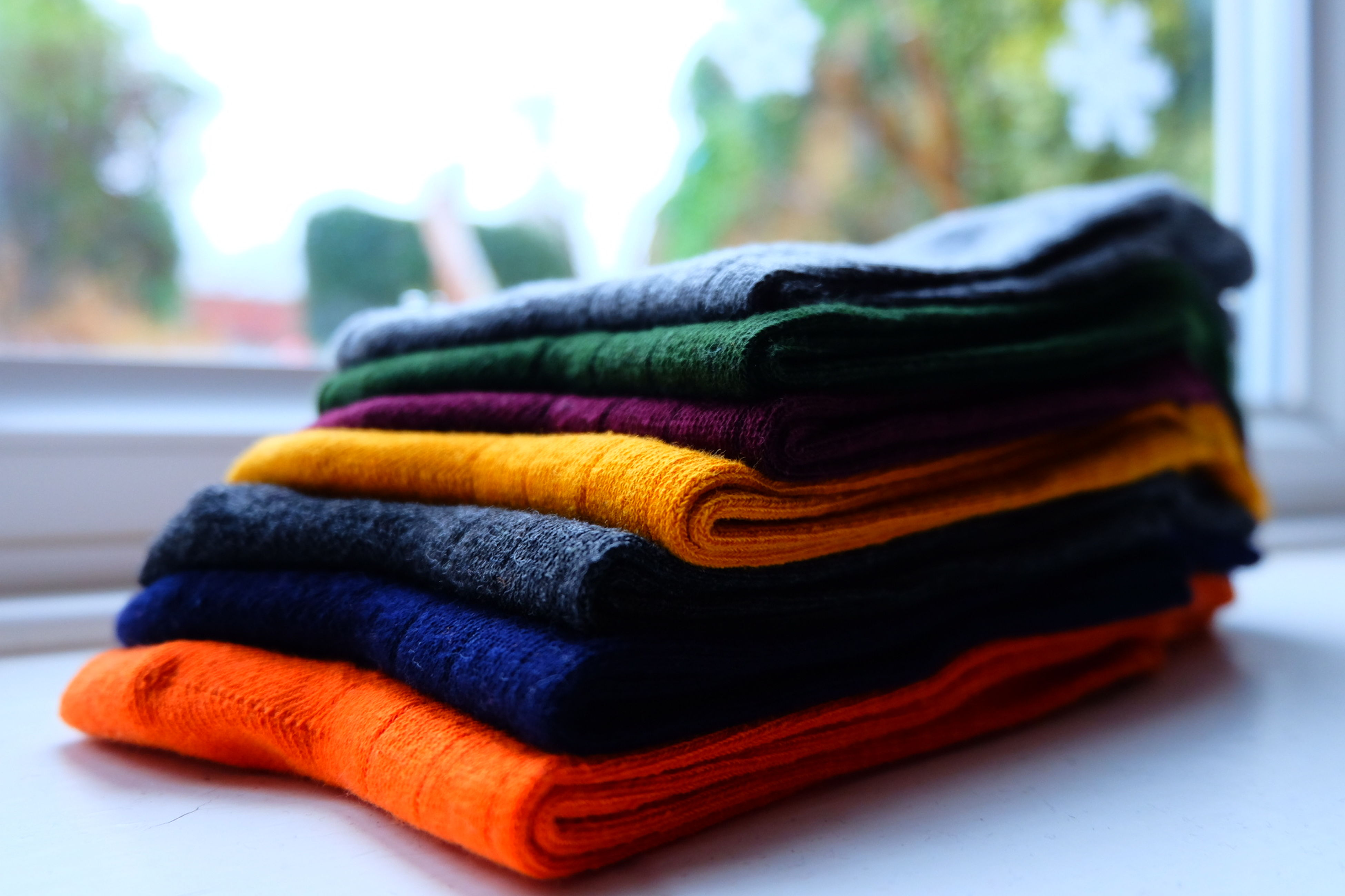 stack, multi colored, focus on foreground, close-up, towel, no people, indoors, day