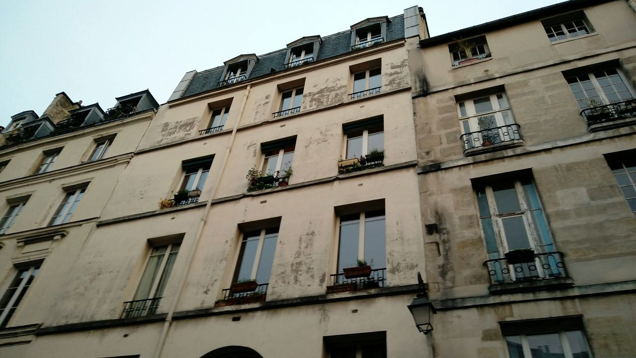 Parisian House Front. · Paris France House Building Building Exterior Façade Architecture Windows Outdoors Low Angle View No People Gray Sky Cloudy Day Simplicity