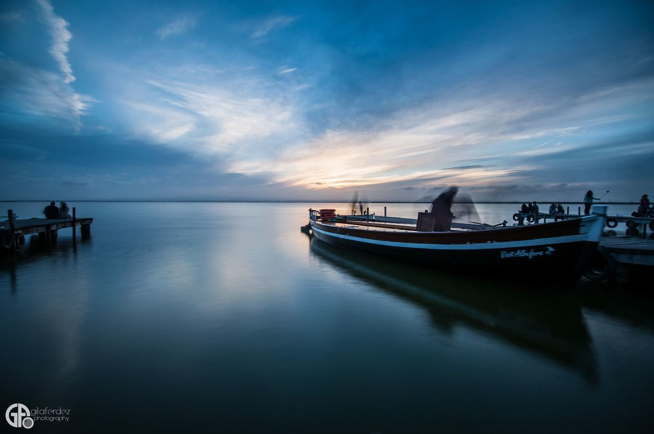 reflection, water, nautical vessel, transportation, sky, nature, sea, mode of transport, moored, beauty in nature, tranquil scene, scenics, tranquility, waterfront, cloud - sky, no people, horizon over water, outdoors, sunset, travel destinations, day
