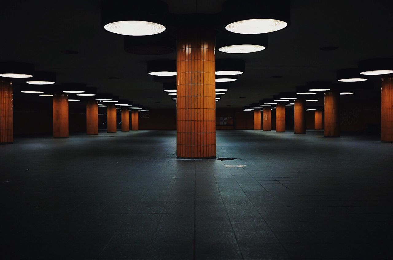 Underground Illuminated Ceiling Lighting Equipment Parking Lot Underground Architectural Column Indoors  In A Row Empty The Way Forward Built Structure Architecture No People Pillar Parking Garage Walkway Orange Berlin Tiles Subway BYOPaper!