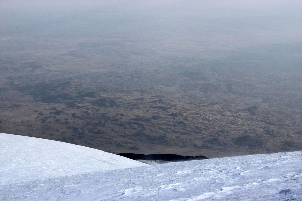 View from the snow covered summit of Mount Ararat in Turkey towards the volcanic moonscape beneath Descent Desert Ice MoonScape Mountaineering No Sky Top Trekking Adventure Ararat  Ağrı Dağı Climbing Cold Down Landscape Mountain Outdoors Peak Plain Scenery Scenics Slope Snow Summit Winter
