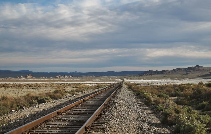 Train to nowhere Desert Pinnacles Rock Formations Beauty In Nature Cloud - Sky Dried Up Lake Geology Landscape Mountains Nature No People Rail Transportation Railroad Track Railway Track Scenics Sky Sunlight And Shadow Tranquil Scene Transportation Trona Pinnacles