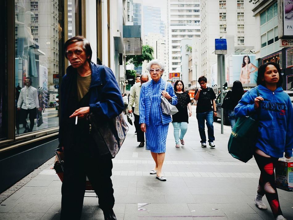 fancy lady, homeless guy, and oversea worker. Samesamebutdifferent. People in Blue. HongKong
