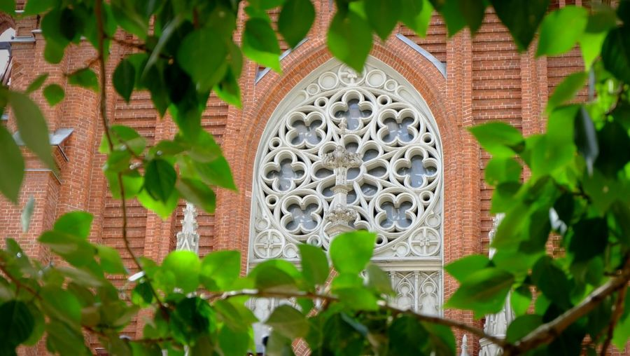 Moscow, Russia Catholic Church Historical Building Color Photography Open Edit Through Foliage Details
