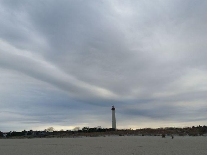 Lighthouse_captures Beach Cloud - Sky Light House On Dramatic Sky