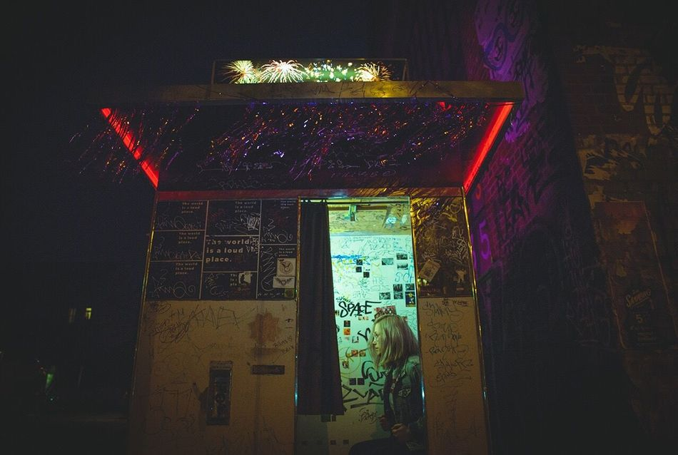 Night Illuminated Low Angle View Architecture Portrait Of A Woman Built Structure Indoors  Multi Colored Building Exterior