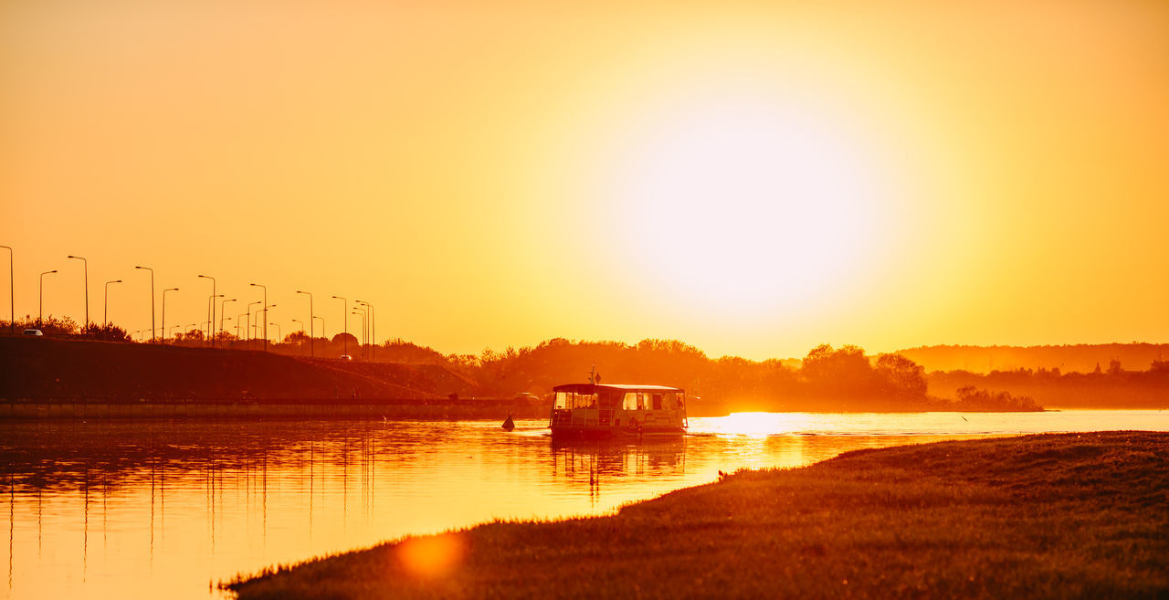 Ferry Beauty In Nature Day Ferry Boat Golden Hour Leisure Activity Lietuva Mode Of Transport Nature Nautical Vessel No People Orange Color Outdoors Reflection River Sailing Scenics Silhouette Sky Sun Sunlight Sunset Tranquility Transportation Water Waterfront