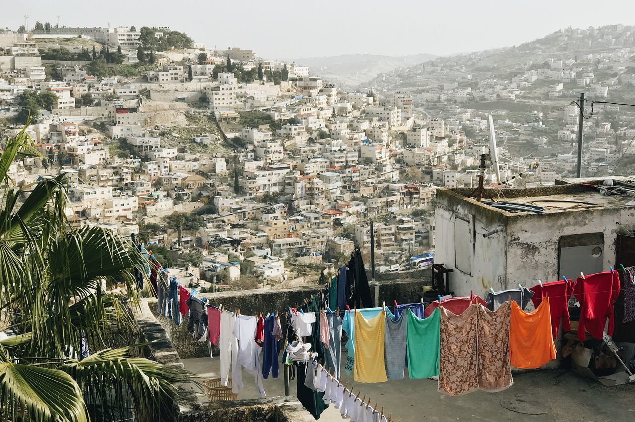 Architecture building exterior built structure City Cityscape clothing day drying Hanging holy land house israel jerusalem mountain Nature no people outdoors residential building sky town