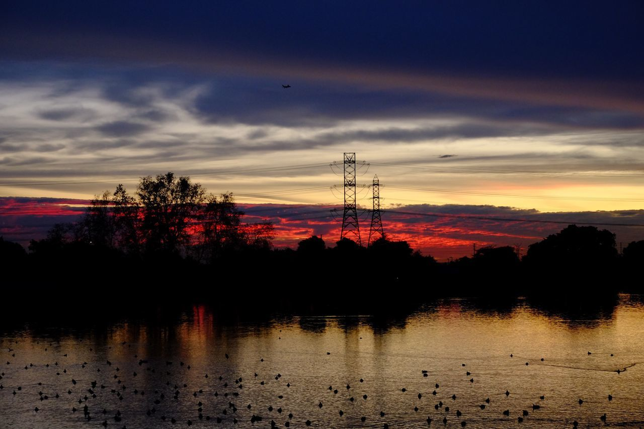Sunset Silhouette Sky Cloud - Sky Water Electricity Pylon No People Nature Outdoors Scenics Tree Beauty In Nature Day NoEditNoFilter Beautiful Nature Dramatic Sky Dusky Sky Rainbow Sky Sky And Clouds Skyporn Amazing Sunset