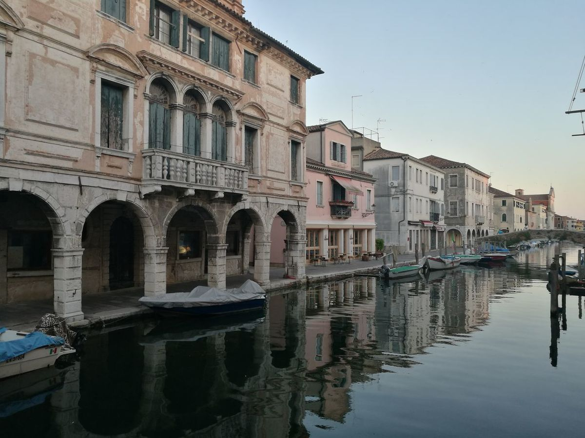 Water Reflection Clear Sky Architecture Flood No People Outdoors Day Gondola - Traditional Boat sunset Golden Hour Sunset_collection Chioggia, Italy The Great Outdoors - 2017 EyeEm Awards Sailing Mode Of Transport Traveling Photography Tranquility