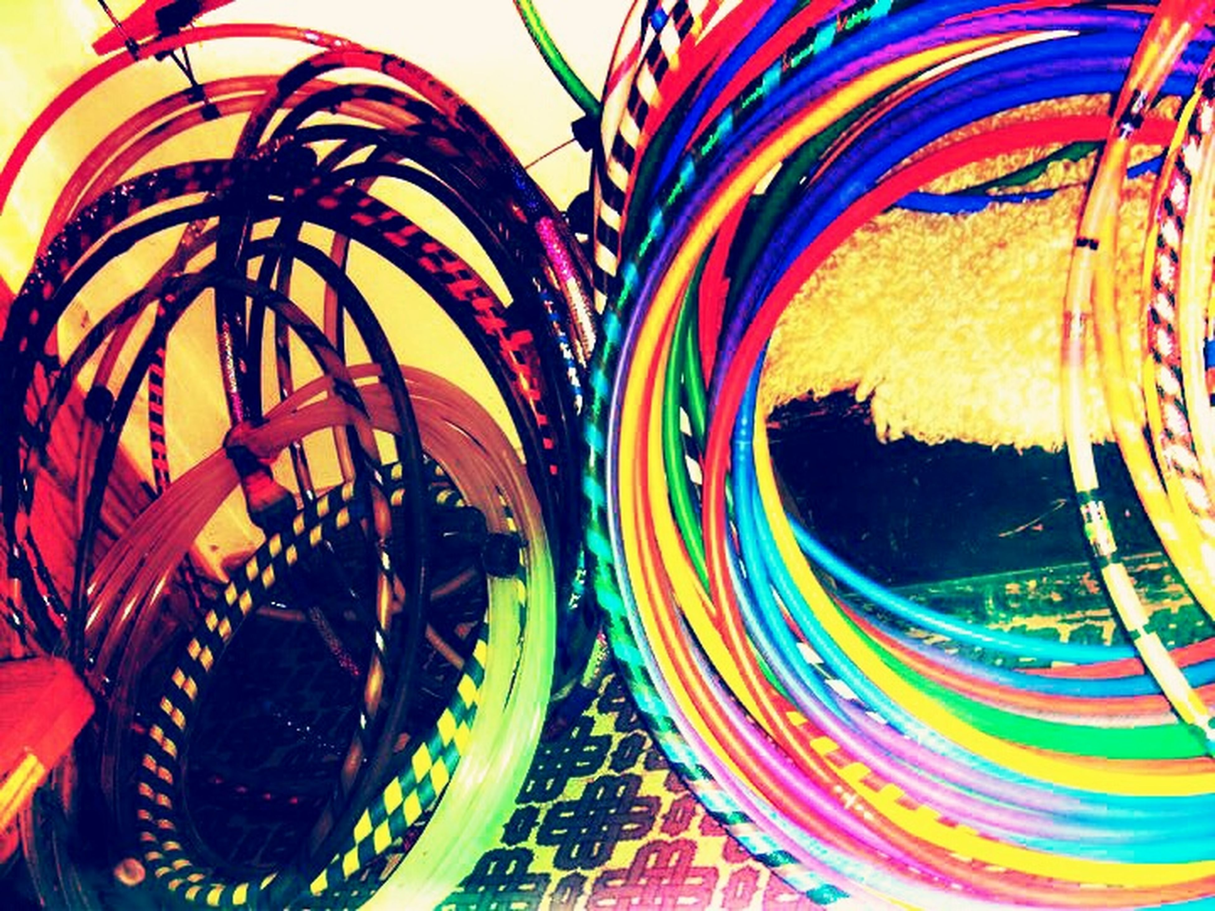 multi colored, circle, close-up, pattern, still life, high angle view, arts culture and entertainment, colorful, amusement park, no people, indoors, geometric shape, ferris wheel, design, art and craft, creativity, art, reflection, day