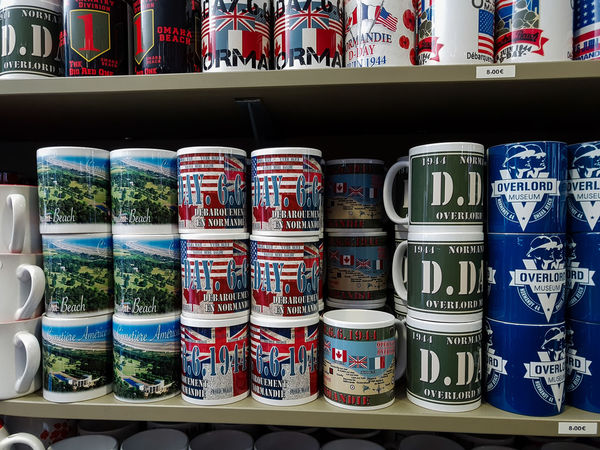 Overlord Museum, Colleville-sur-mer, Normandy, France, July 2017 D-Day Operation Overlord Overlord Museum Choice For Sale In A Row Large Group Of Objects Market Multi Colored Museum Overlord Shelf Souvenirs Souvenirshop Variation
