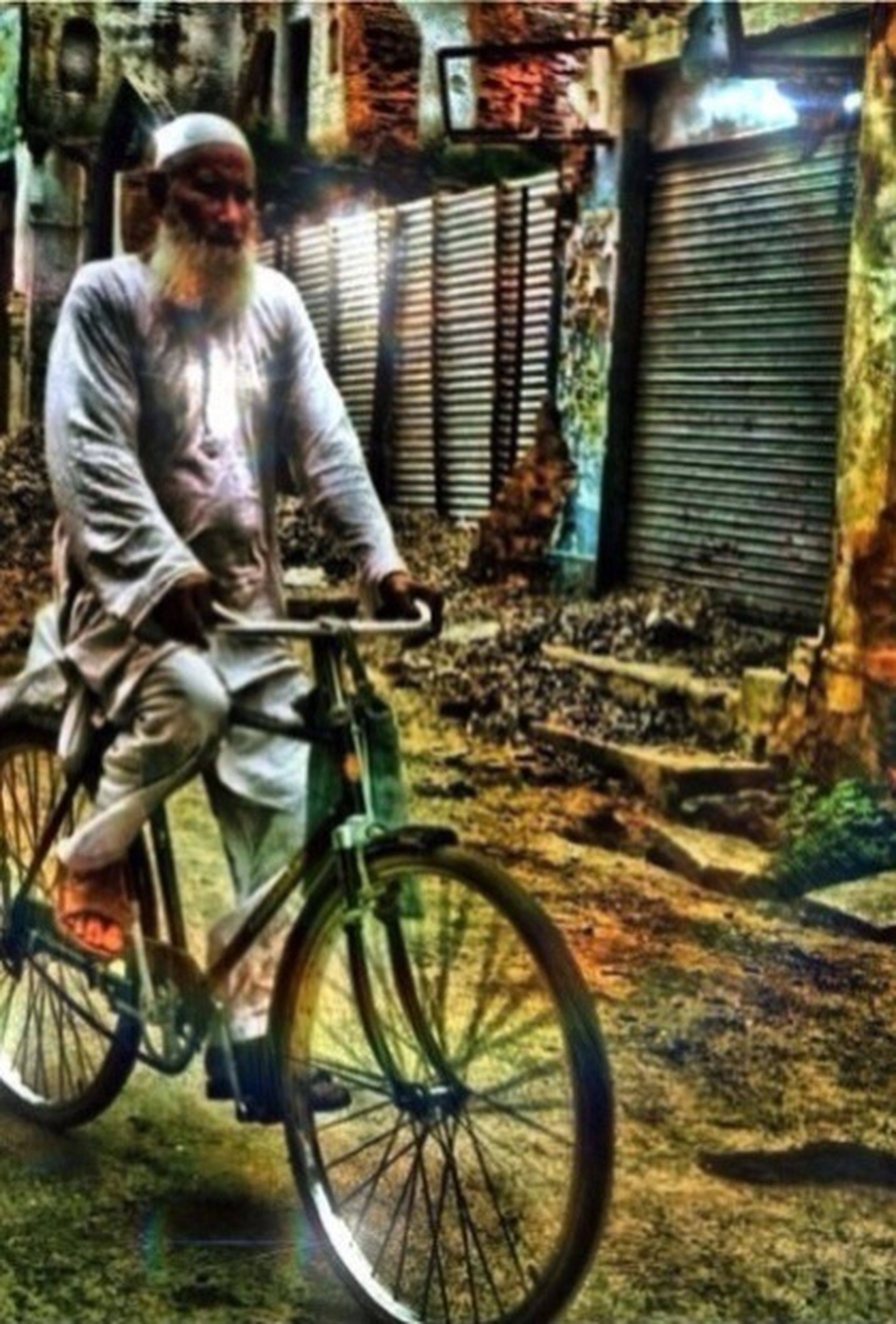 bicycle, mode of transport, transportation, land vehicle, lifestyles, full length, architecture, street, leisure activity, building exterior, built structure, casual clothing, side view, blurred motion, riding, men, graffiti, day