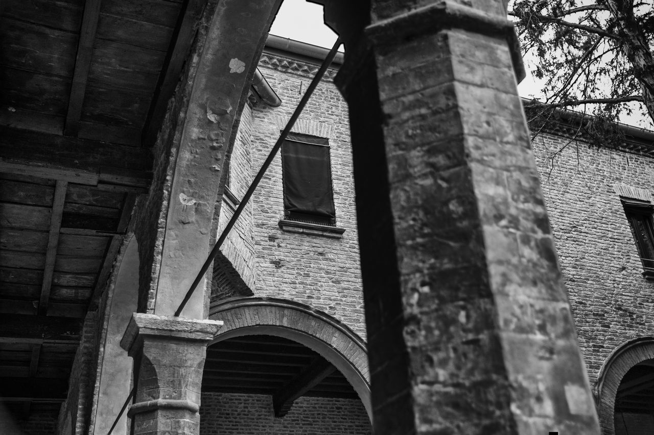 Arch Architecture Black & White Black And White Brick Bricks Building Exterior Built Structure Cloister Column Columns Day EyeEm Gallery Low Angle View No People Outdoors Tranquility Tree Trees Wall Window Windows