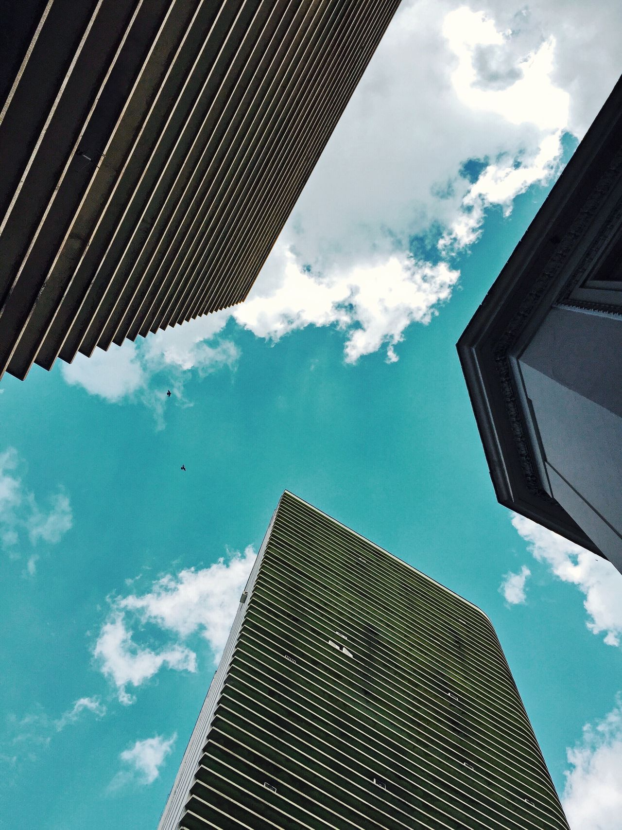 Sky Cloud - Sky Low Angle View Building Exterior Architecture Built Structure Cloud Day Outdoors Blue Skyscraper Window No People Modern City Growth