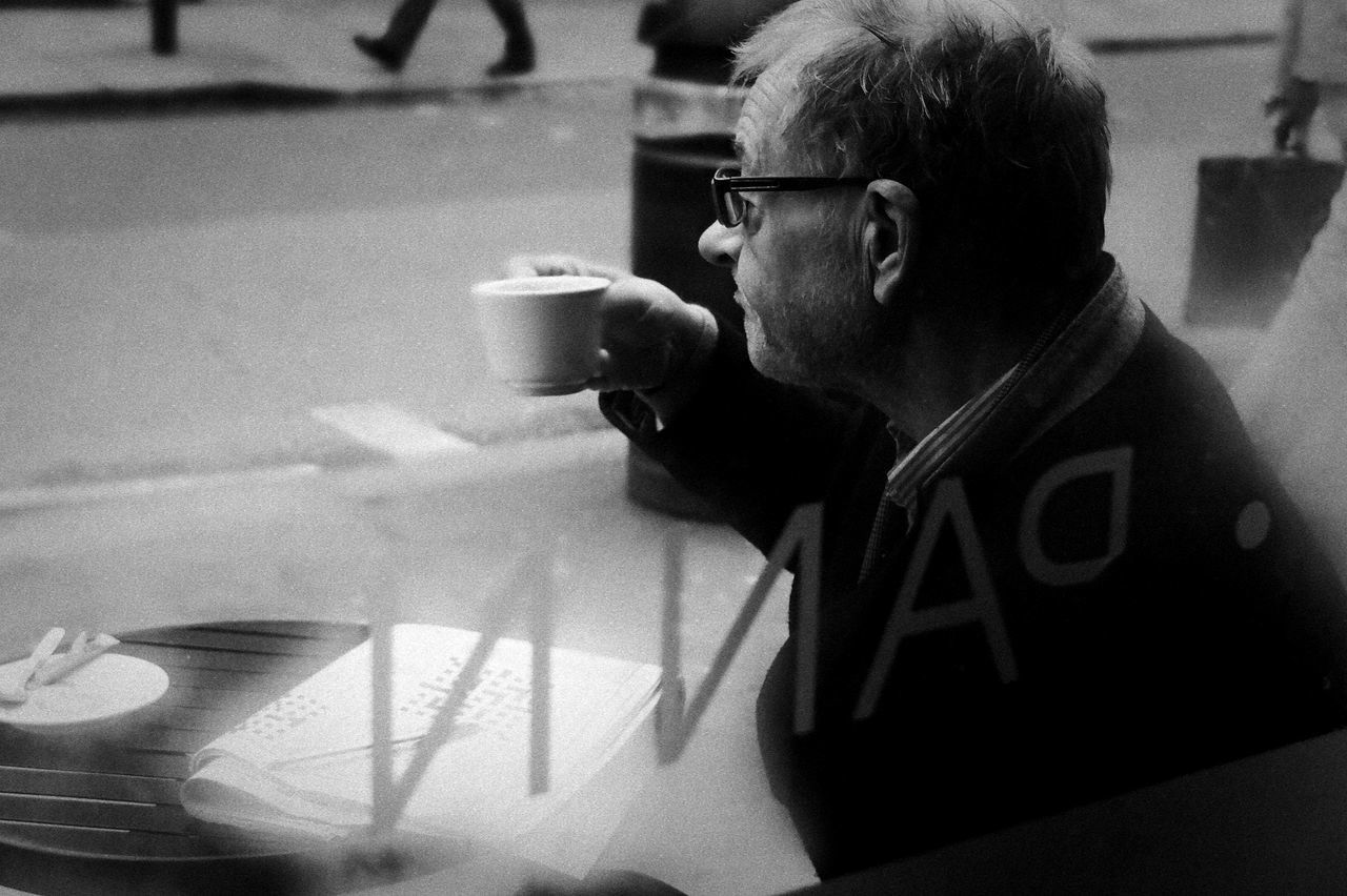 Coffee Drinker through Window Black And White Monochrome Old Man With Glasses Close-up Coffee And Cigarettes Documentary Nature Photography Photography Taking Photos A Drink Fashion Focus On Foreground Food And Drink Hobbies Holding Human Hand Indoors  Music Occupation One Person Out Door Coffee Drinker Part Of Refreshment Reportage Street Photos Taking Fotos Images Photographic Camera Lens Architectural Design Building Structual Support Detail Of Tower Block In Sunshine Blue Sk Selective Focus Single Object Still Life Studio Shot Table Technology