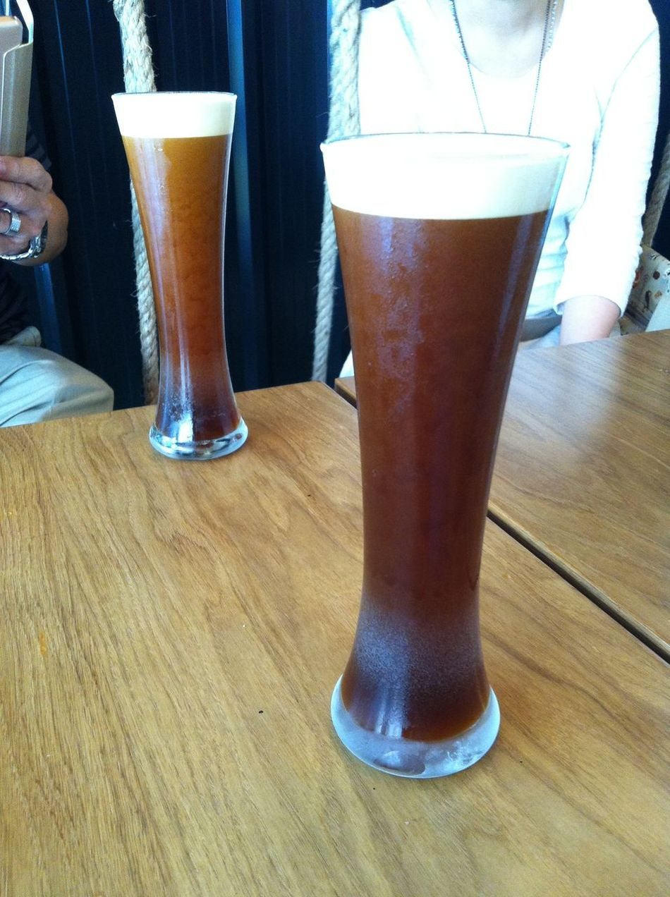 Look like Beer but it isn't. It's Nitro-Brewed Coffee. Beer Glass Close-up Coffee - Drink Cold Temperature Drink Drinking Glass Food And Drink Freshness Friendship Froth Frothy Drink Happy Hour Human Body Part Human Hand Indoors  Low Section Men Nitro-brewed Non-alcoholic Beverage Pint Glass Real People Refreshment Relaxing Moments Table Wood - Material