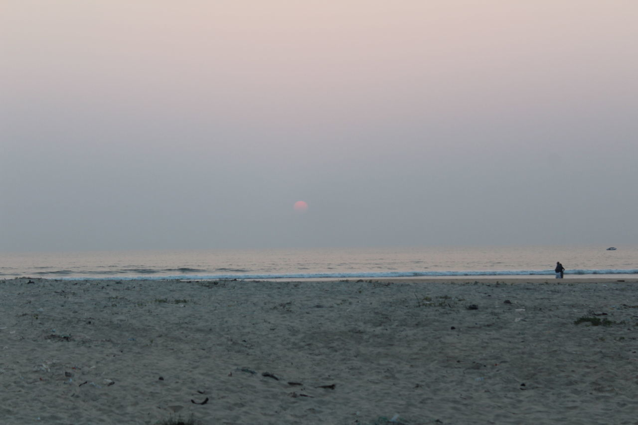 sea, beach, shore, nature, water, horizon over water, sand, beauty in nature, scenics, tranquility, sunset, sky, outdoors, one person, day, people