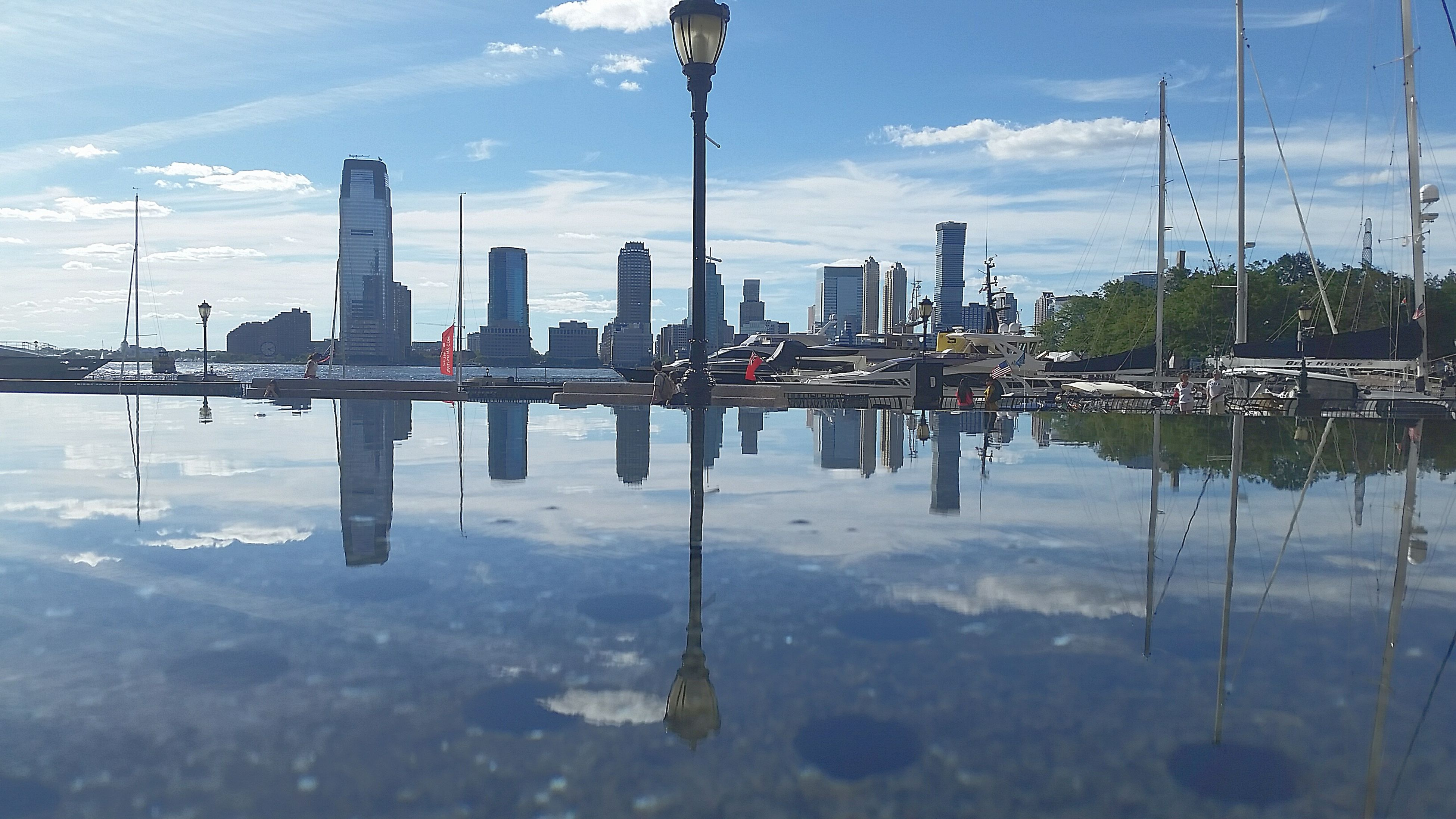 water, reflection, waterfront, sky, lake, sailboat, standing water, calm, cloud - sky, cloud, tranquil scene, tranquility, day, scenics, growth, skyscraper, tall, reflection lake, building story, development, vacations