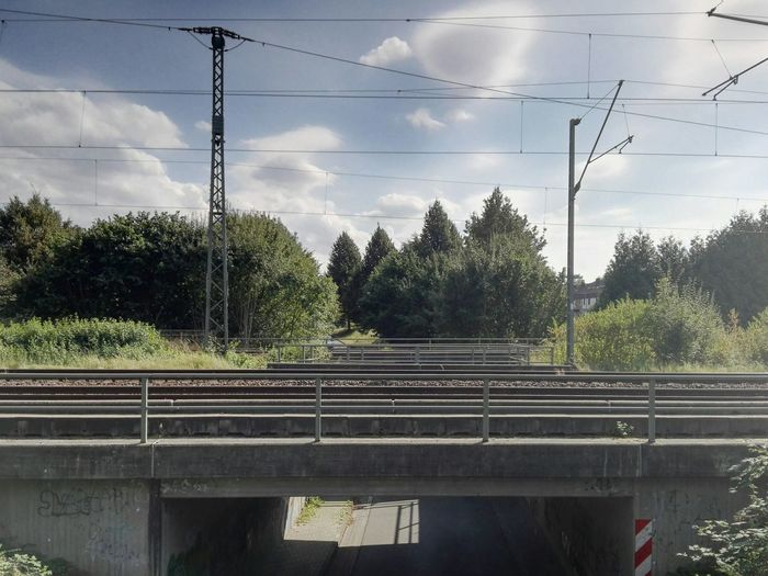 Die Brücke Tree Sky Cable Transportation Railroad Track Power Line  Cloud Day Power Cable Electricity Pylon Cloud - Sky Growth Tranquil Scene Tranquility Railway Track Outdoors Nature Solitude Scenics No People
