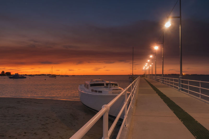 Dusk at a jetty Beach Boat Business Finance And Industry Dusk Leading Lines Night No People No People, Ocean Outdoors Rockingham Rockingham Foreshore Sea Sky Sunset Travel Destinations Water