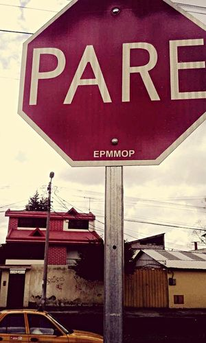 PARE! Text Red Communication Road Sign Stop Sign No People Day Sky Outdoors Architecture Close-up Architecture Quito