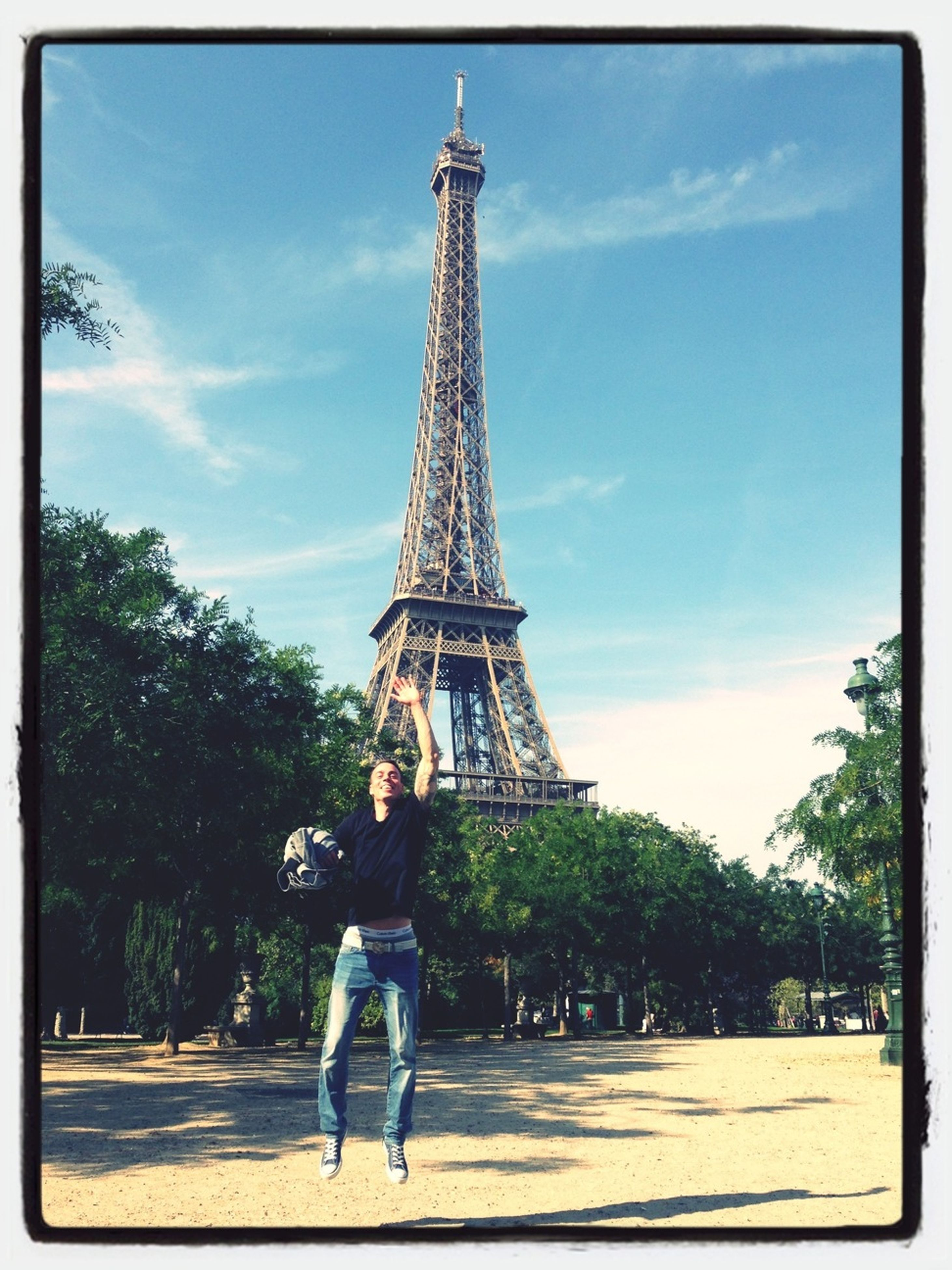 architecture, built structure, transfer print, sky, famous place, eiffel tower, lifestyles, tower, building exterior, tourism, travel destinations, leisure activity, international landmark, capital cities, person, tree, tall - high, travel, men