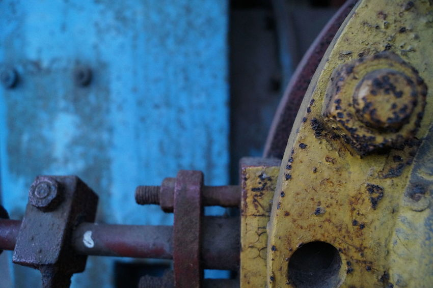 Vintage details Close-up Rusty Weathered Metal No People Outdoors Vintage Old Buildings Industry Full Frame Vintage Objects Factory Steelwork Ironworks Technology Workers Abandoned Architecture Built Structure Round Objects Pipe Blue Yellow Building Exterior The Architect - 2017 EyeEm Awards