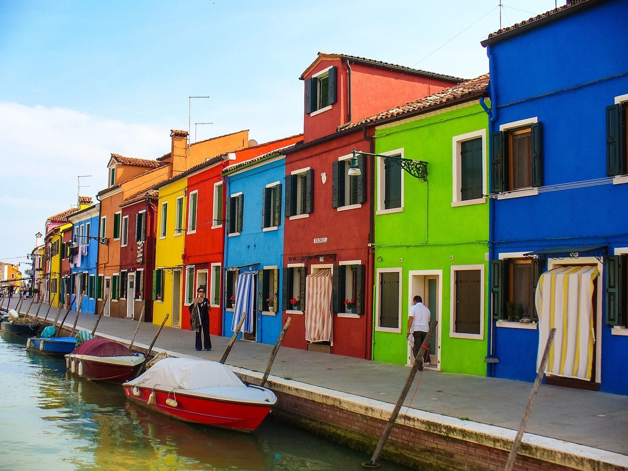 Burano Burano Island Burano, Italy Building Exterior Architecture Nautical Vessel Transportation Built Structure Mode Of Transport Outdoors Sky Moored Real People Water Men Day Vibrant House Colorful Houses Row Of Houses Home Exterior Design Home Exterior House Paint Vibrant Rows Of Things