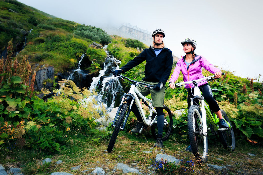 Action Active Adventure Bicycle Cloudy Couple Cycling Fun Men Motion Mountains MTB MTB ADVENTURE MTB Biking Nature Outdoors People Person Road Sport Sports Street Switzerland Two People Women