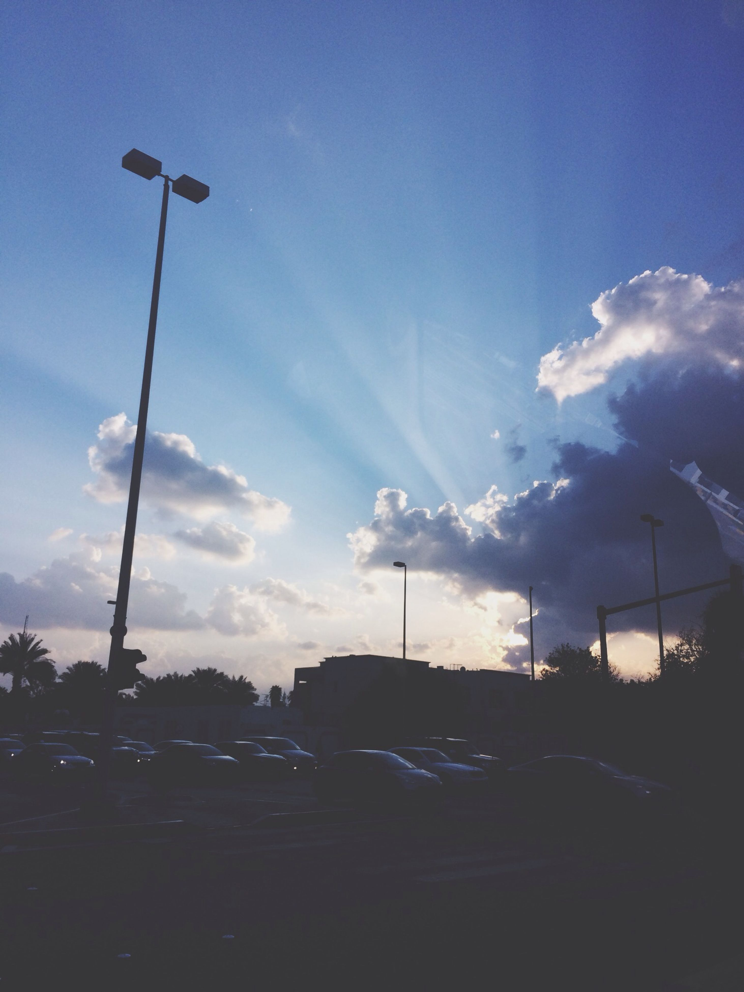 street light, transportation, sky, car, road, street, land vehicle, lighting equipment, blue, mode of transport, tree, silhouette, sunlight, the way forward, sun, cloud - sky, outdoors, nature, sunset, cloud