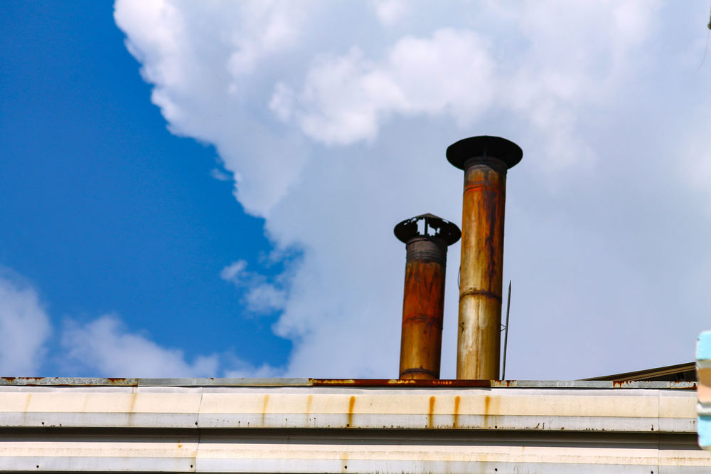 EyeEm Selects Cloud - Sky Architecture Low Angle View Day Sky No People Smoke Stack Built Structure Outdoors Building Exterior Close-up Industrial Industrialization Modern Factory Environmental Issues Air Pollution Green Gas Production Facilities