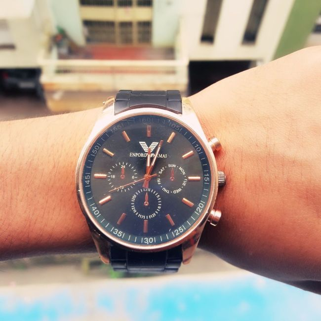 Time Clock Focus On Foreground Person Close-up Roman Numeral Building Exterior Circle Geometric Shape Memories Metal Classy Royal Armani❤ Time Is Money First Eyeem Photo