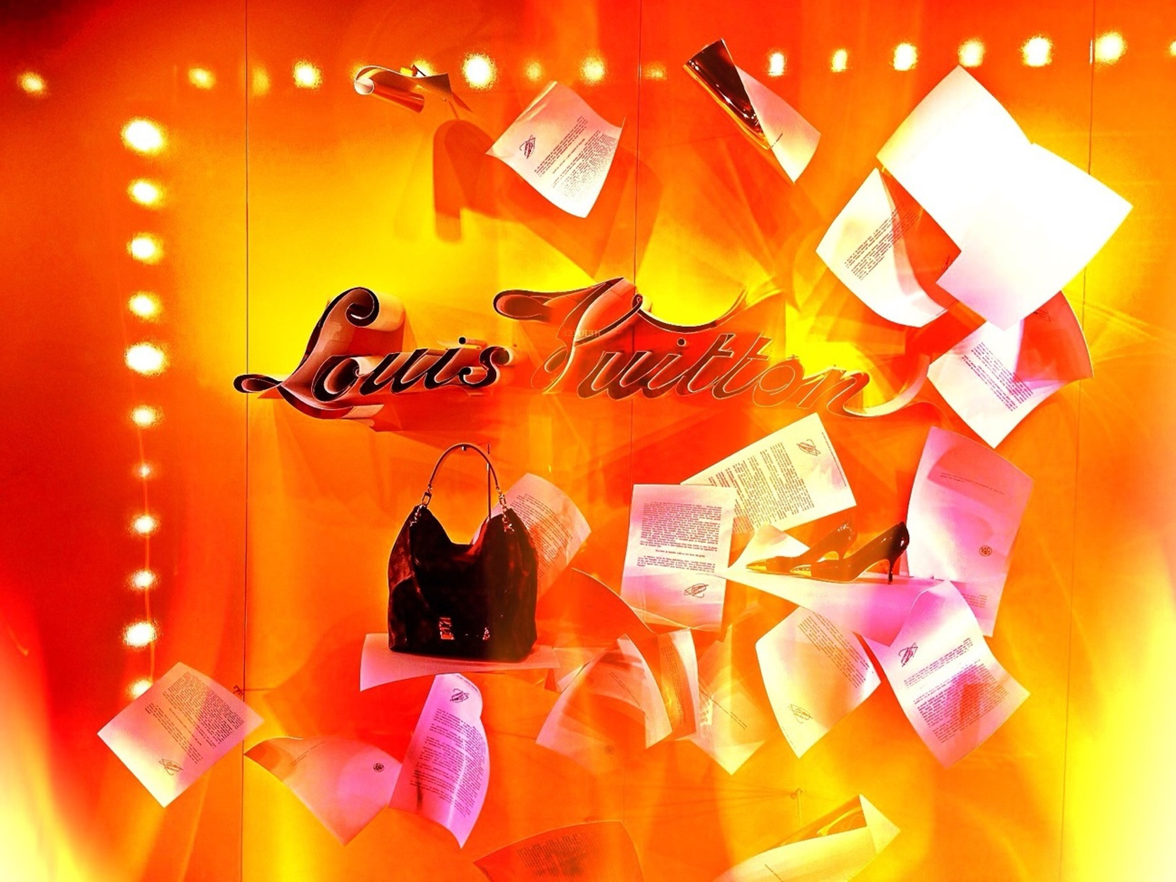 text, communication, western script, indoors, orange color, red, close-up, hanging, non-western script, illuminated, yellow, no people, wall - building feature, paper, variation, sign, guidance, number, multi colored, still life