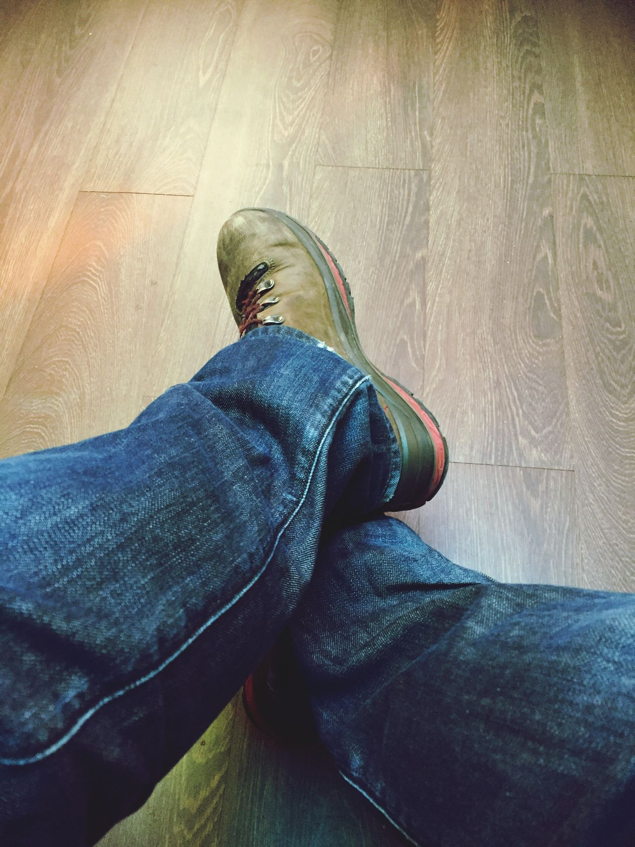 Lifestyles Real People One Person Jeans Human Leg Low Section Personal Perspective Leisure Activity Shoe Human Body Part Sitting Men Day Close-up Indoors  Mammal People Adult Waiting Sitting Waitingroom Shoes Jeans Floor Wood