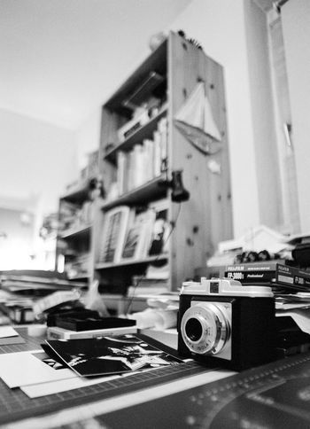 photographers Blurry Desk - or should i say Messy Desk ... ;) Home Is Where The Art Is Showing Imperfection Close-up Focus On Foreground Indoors  Kamera No People Selective Focus Blackandwhite Film Photography Monochrome Schwarzweiß Black And White Analogue Photography