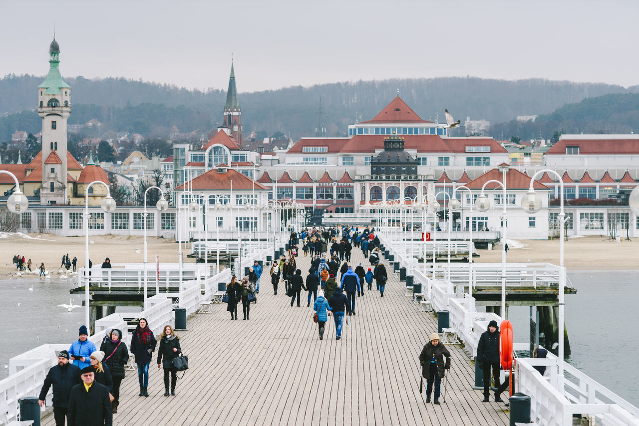 Pier in Sopot Architecture Baltic Sea Building Exterior City Cityscape Cold Temperature Crowd Day Explore City Ice Rink Large Group Of People Medieval Outdoors People Roof Sky Tower Travel Travel Destinations Walking Winter