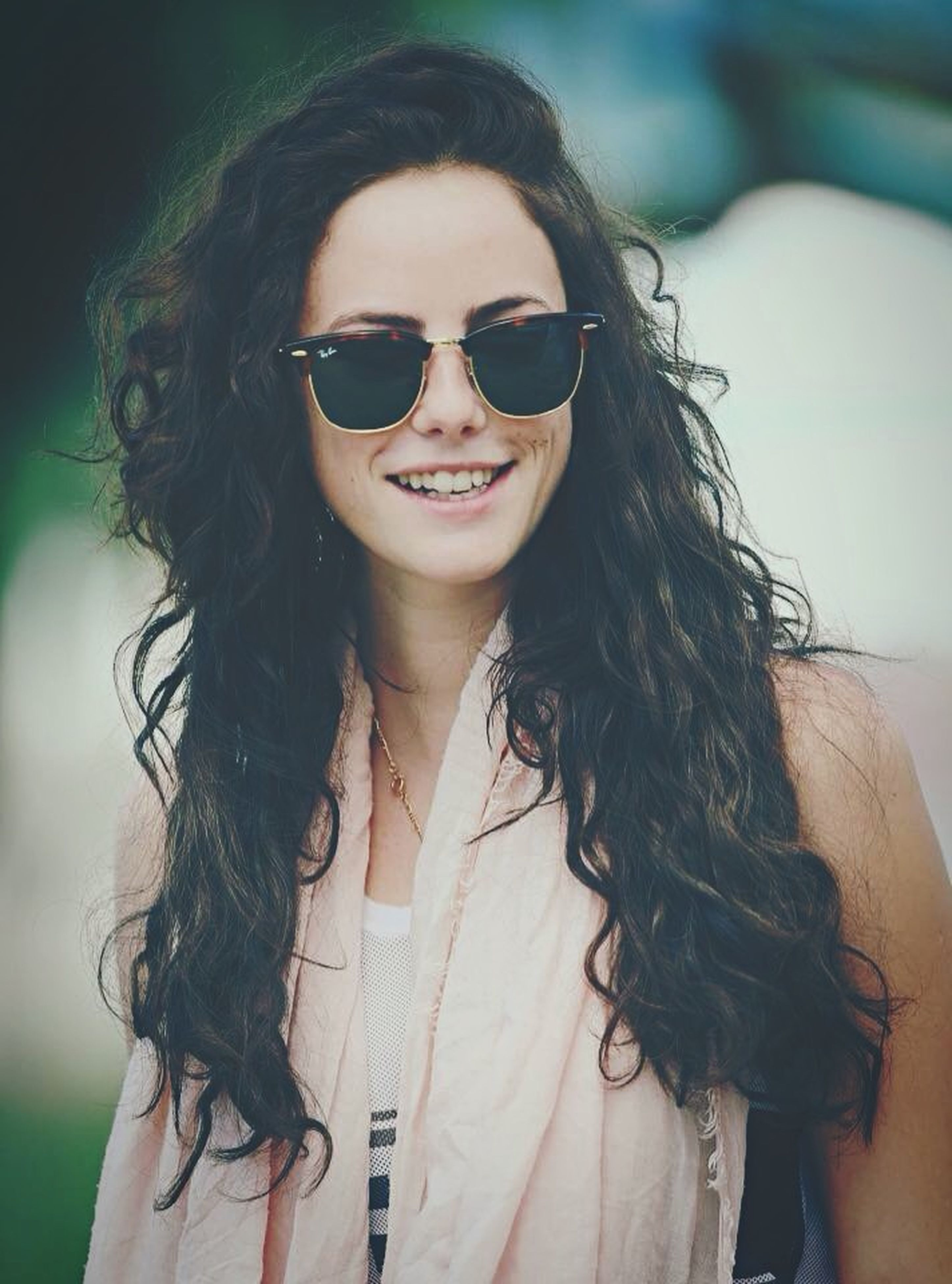 young adult, lifestyles, young women, portrait, looking at camera, front view, person, leisure activity, long hair, casual clothing, sunglasses, focus on foreground, smiling, waist up, headshot, fashion, black hair