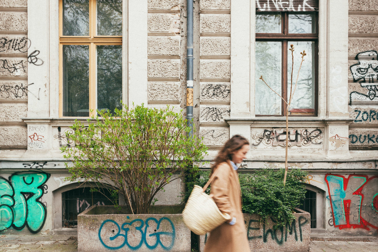 Urban Kollwitz. Adult Adults Only Architecture Beautiful Woman Berlin Blur Building Exterior Built Structure Casual Clothing City Day Graffiti Long Hair Motion One Person One Woman Only Only Women Outdoors People Prenzlauerberg Real People Standing Symmetry Young Adult Young Women