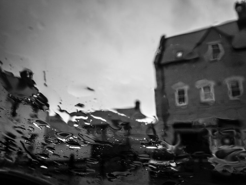 View of a rainy day from inside a car. Cloudy Distorted Distorted View England English Countryside English Weather Gloomy Gloomy Day Gloomy Weather Haunted House Raindrops Rainy Rainy Days