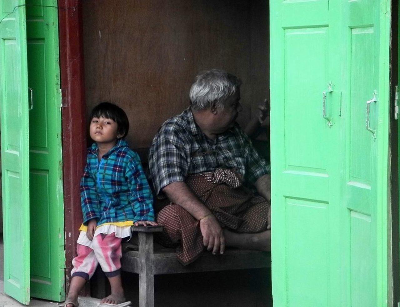 Child And Adult Childhood Door Green Doors Happiness Simplicity Staring Wood
